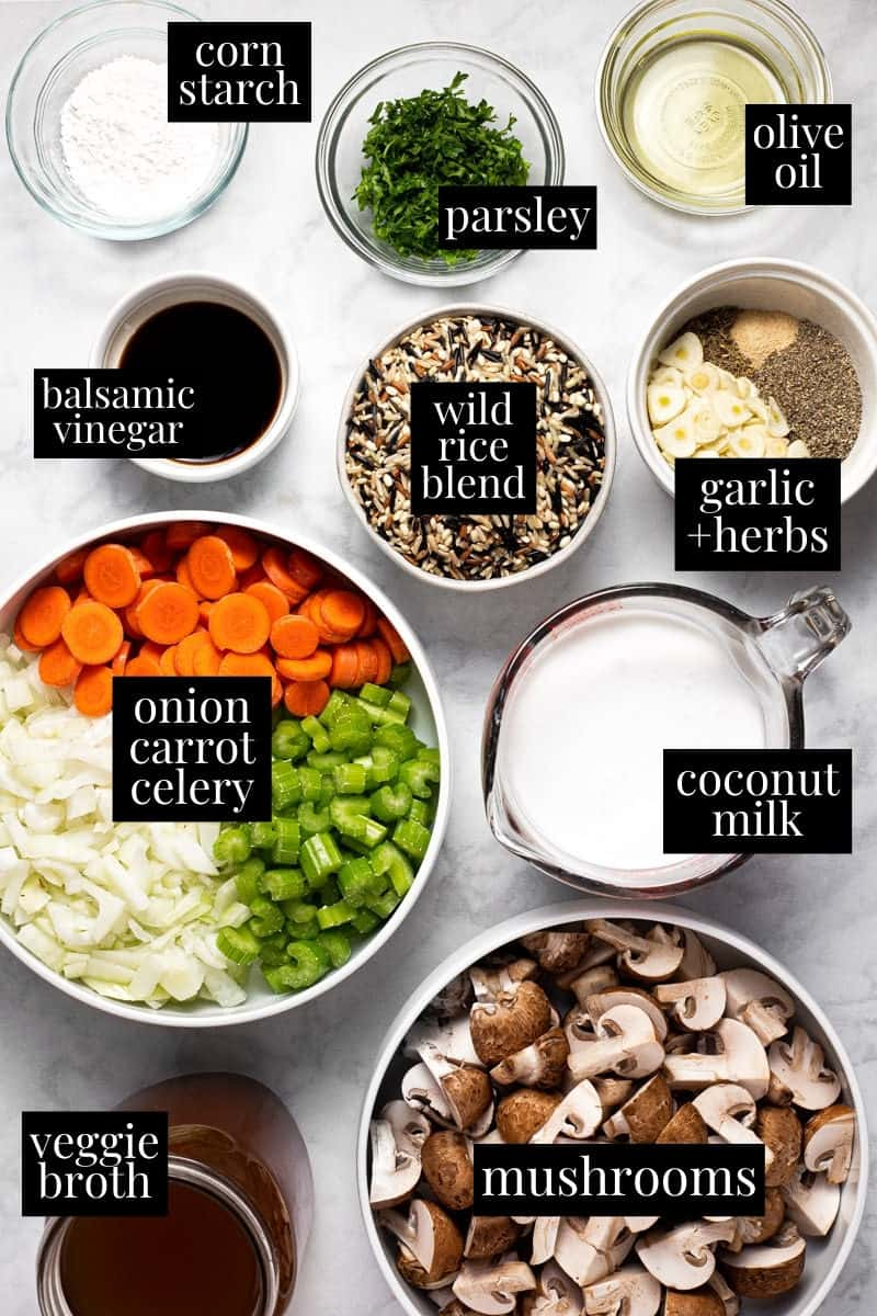White marble counter top with ingredients to make vegan wild rice mushroom soup