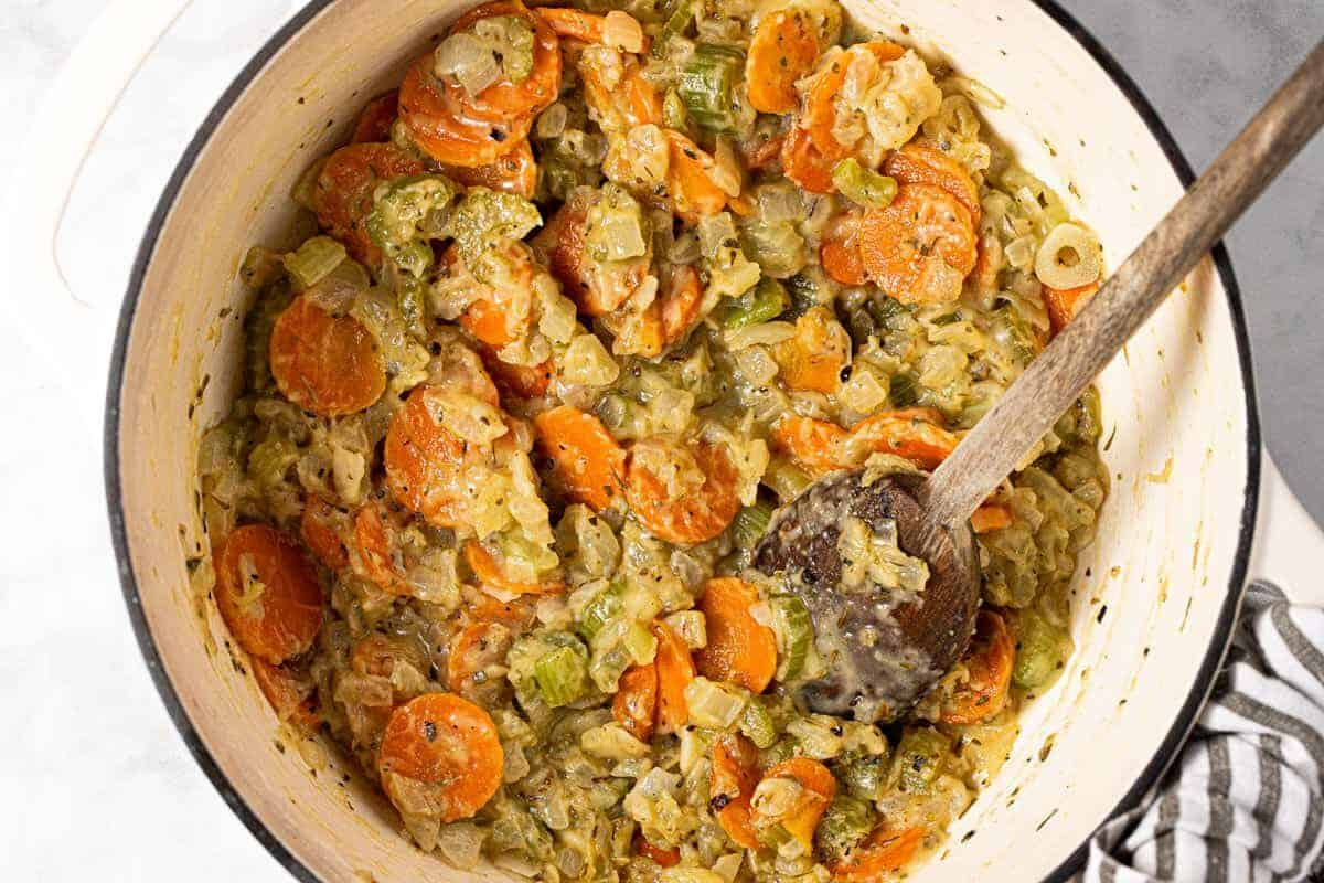 Large pot filled with sautéed veggies coated in flour and butter