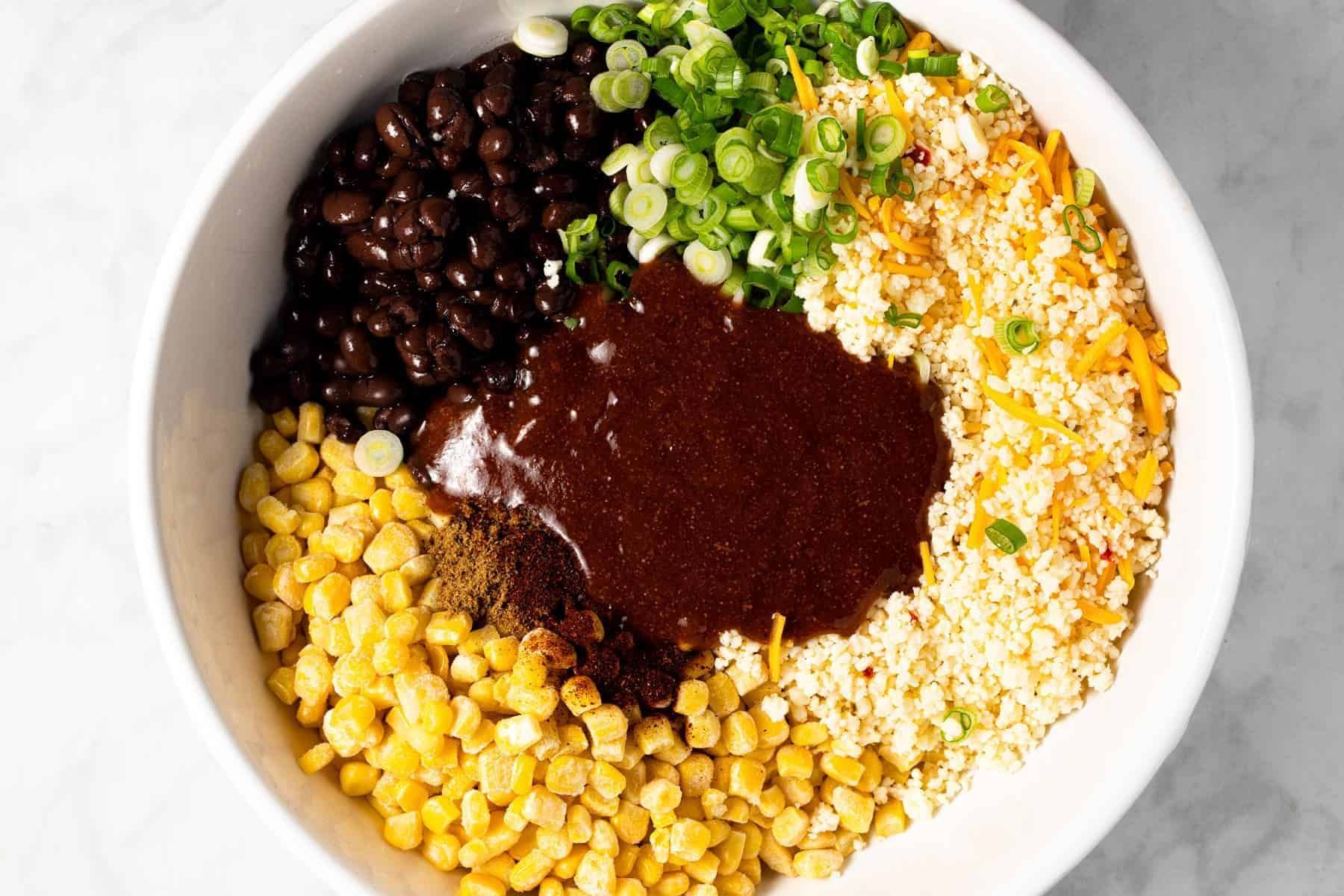 Large white bowl filled with ingredients to fill enchiladas