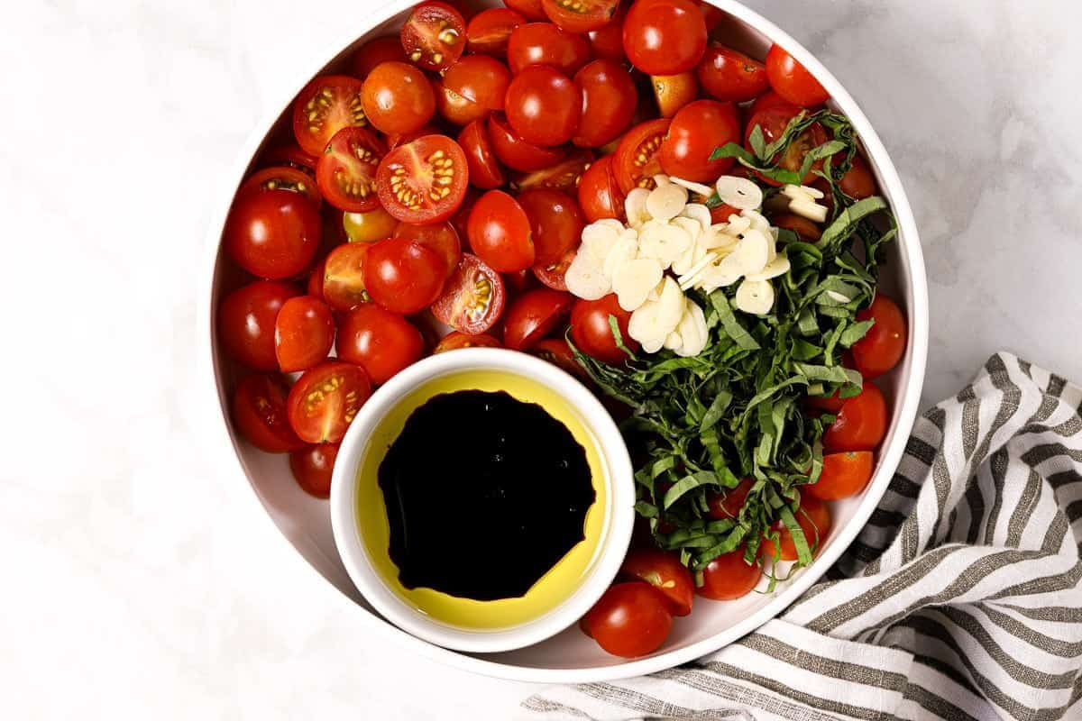 Large bowl with ingredients to make tomato bruschetta