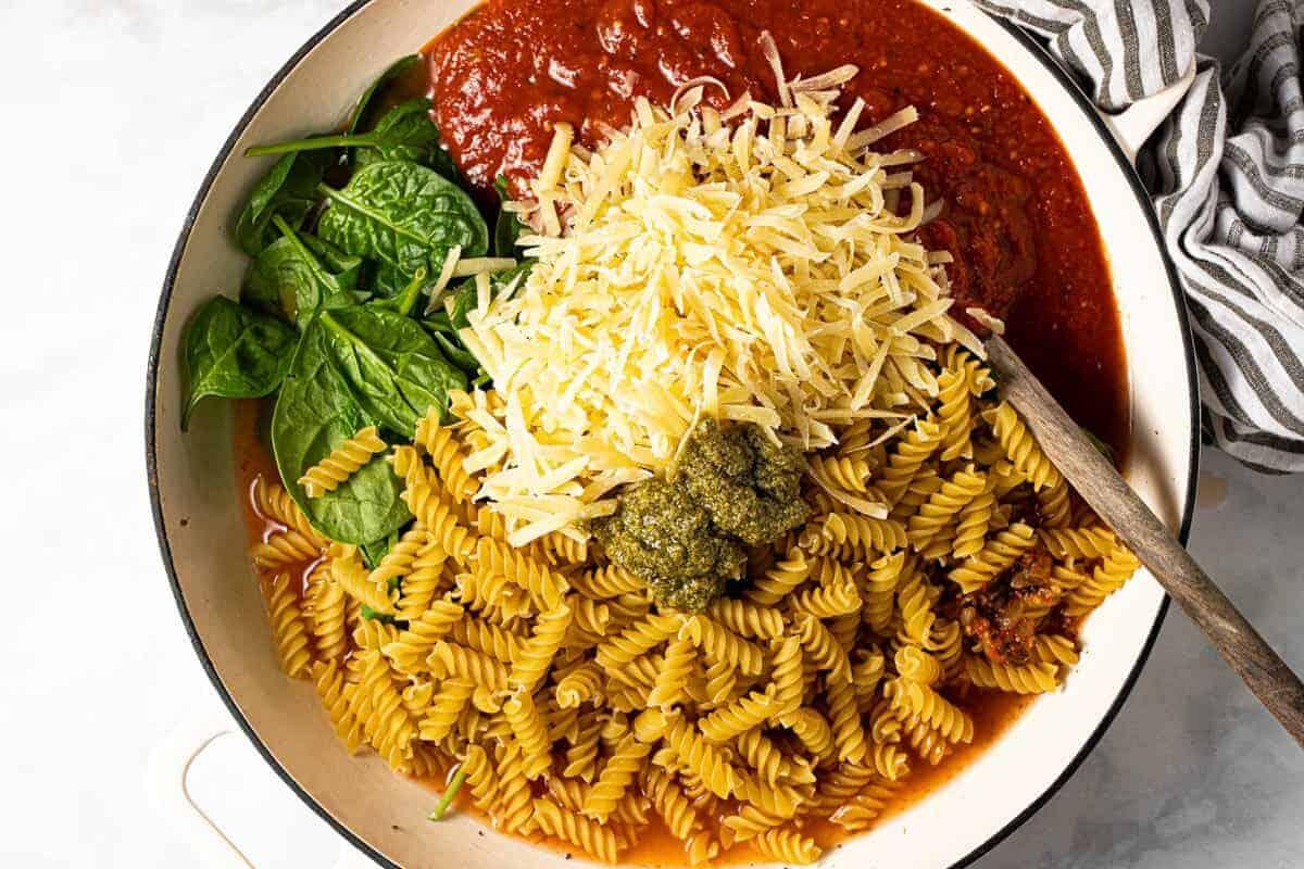 Large pan filled with ingredients to make no boil pasta bake