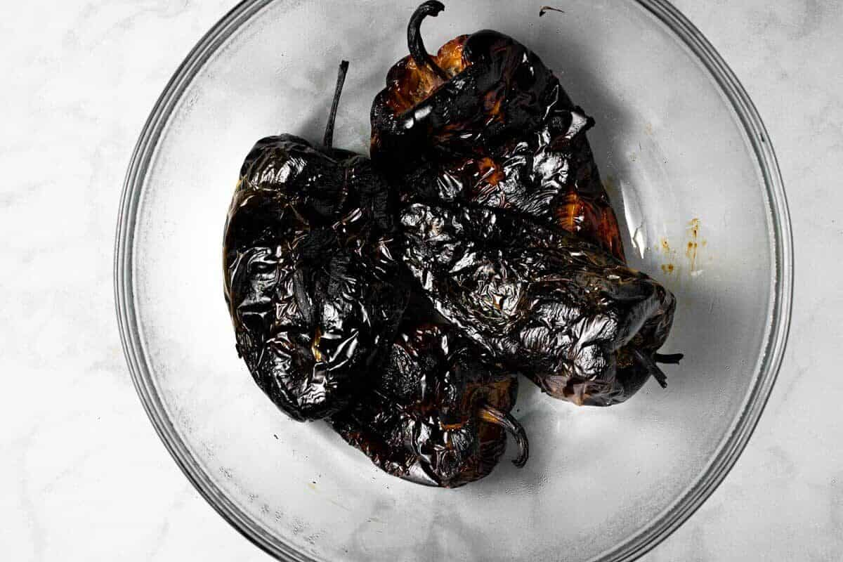 Glass bowl filled with charred peppers