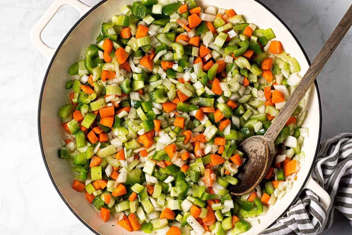 Diced veggies in a large saute pan with olive oil