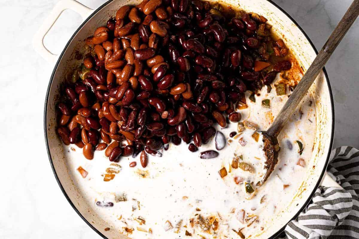 Large white pan filled with ingredients to make red beans and rice