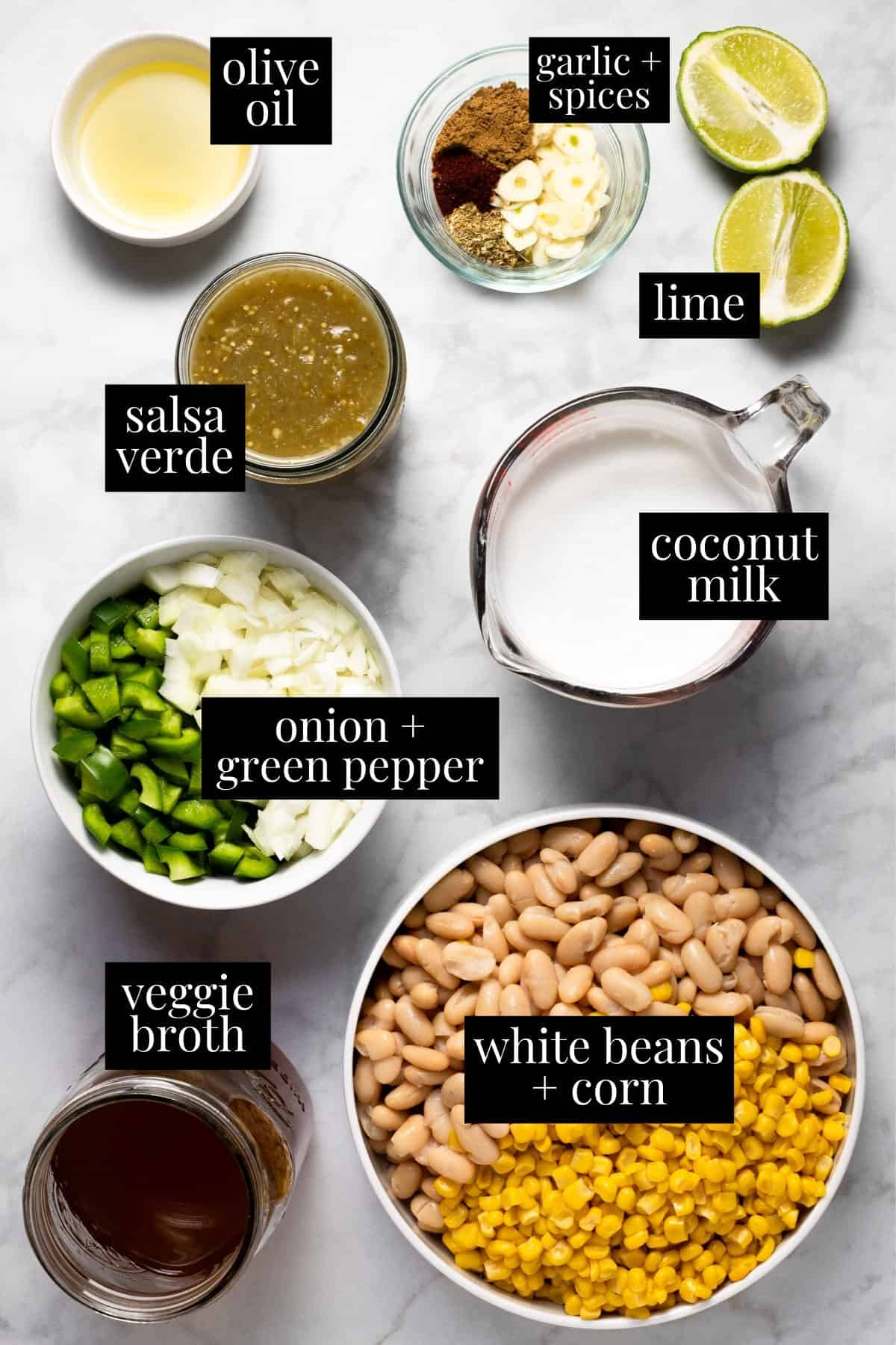 White marble counter top with ingredients to make white bean chili