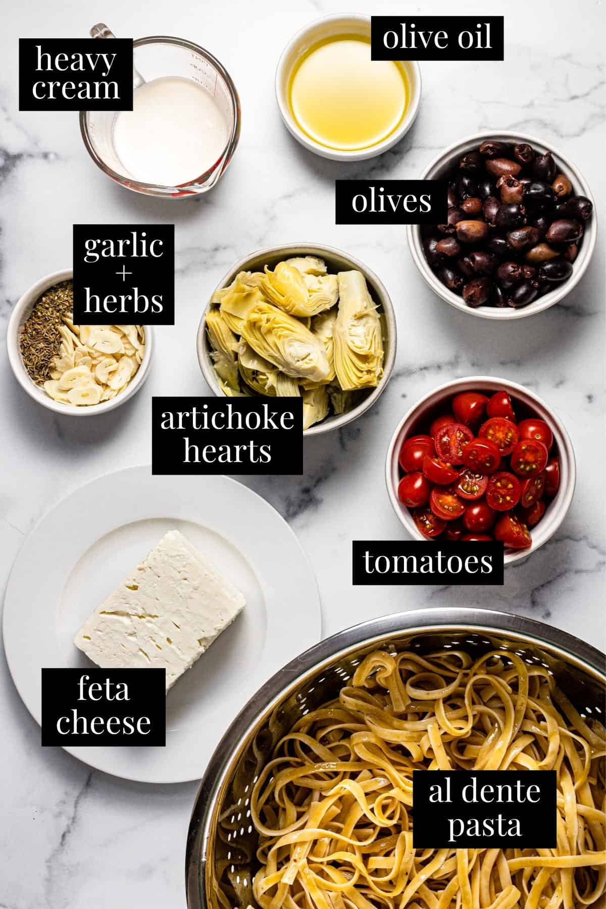 White marble counter top with ingredients to make easy creamy Mediterranean pasta
