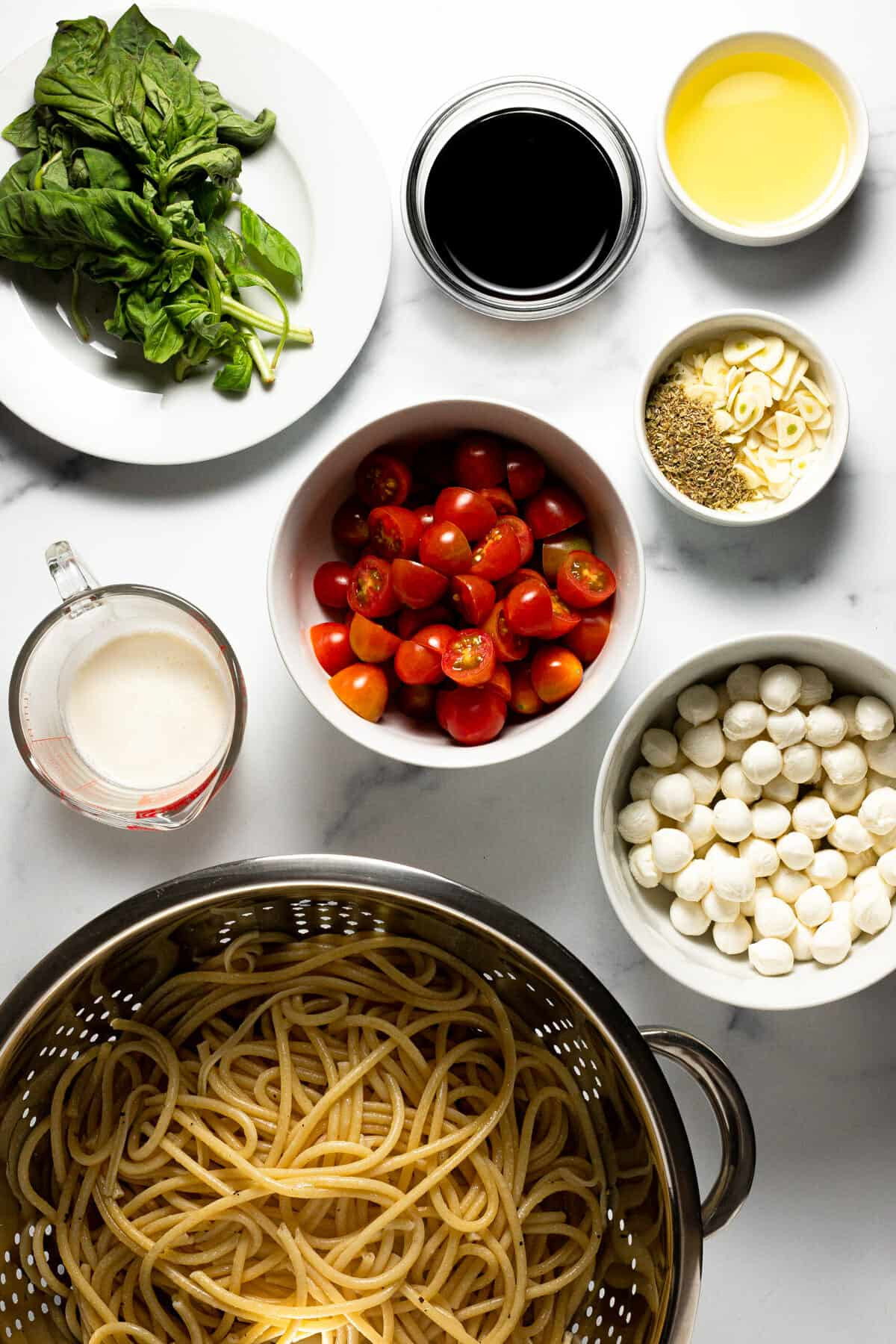 White marble countertop with ingredients to make bruschetta pasta