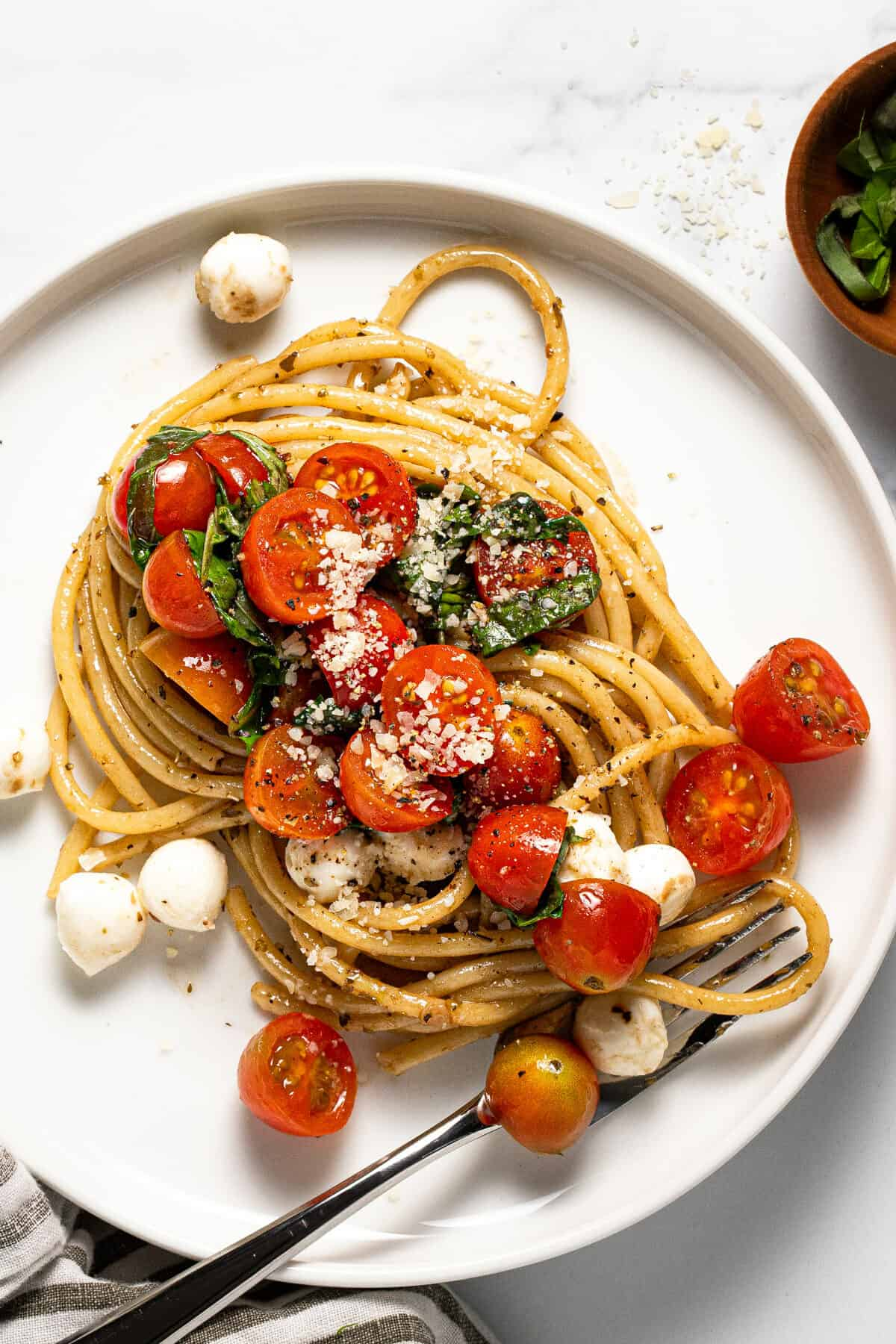 Large white plate filled with bruschetta pasta