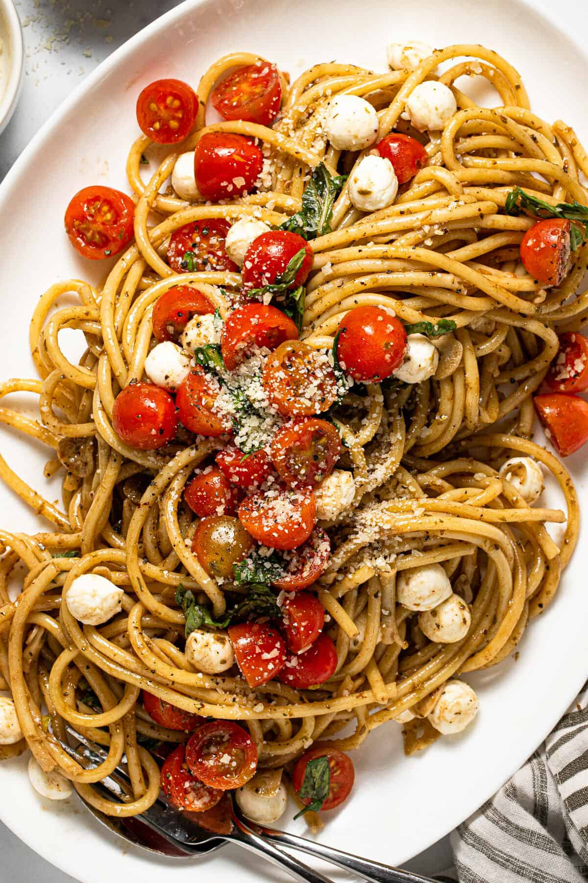 Large white serving platter filled with bruschetta pasta