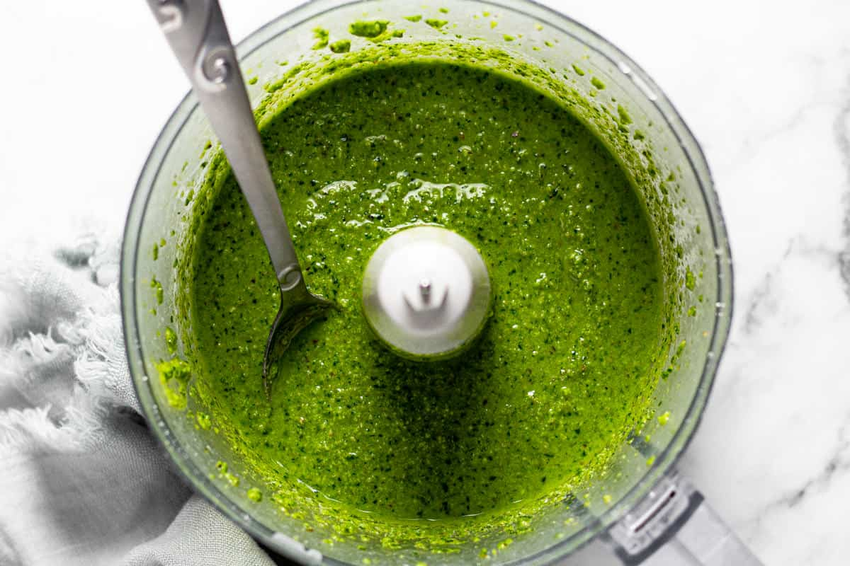 Food processor filled with homeade basil pesto