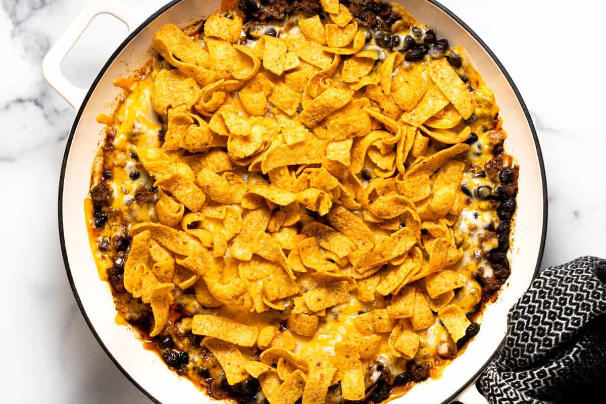 Large white pan filled with ingredients to make walking taco casserole