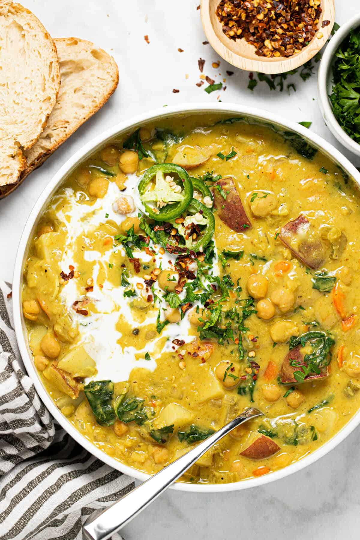 Large white bowl filled with creamy curry chickpea stew