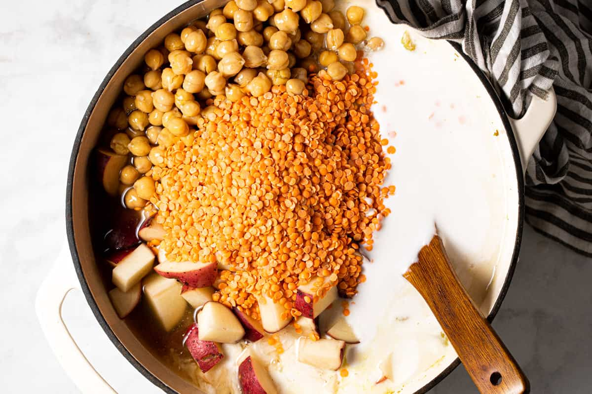 Large pot filled with ingredients to make chickpea curry stew