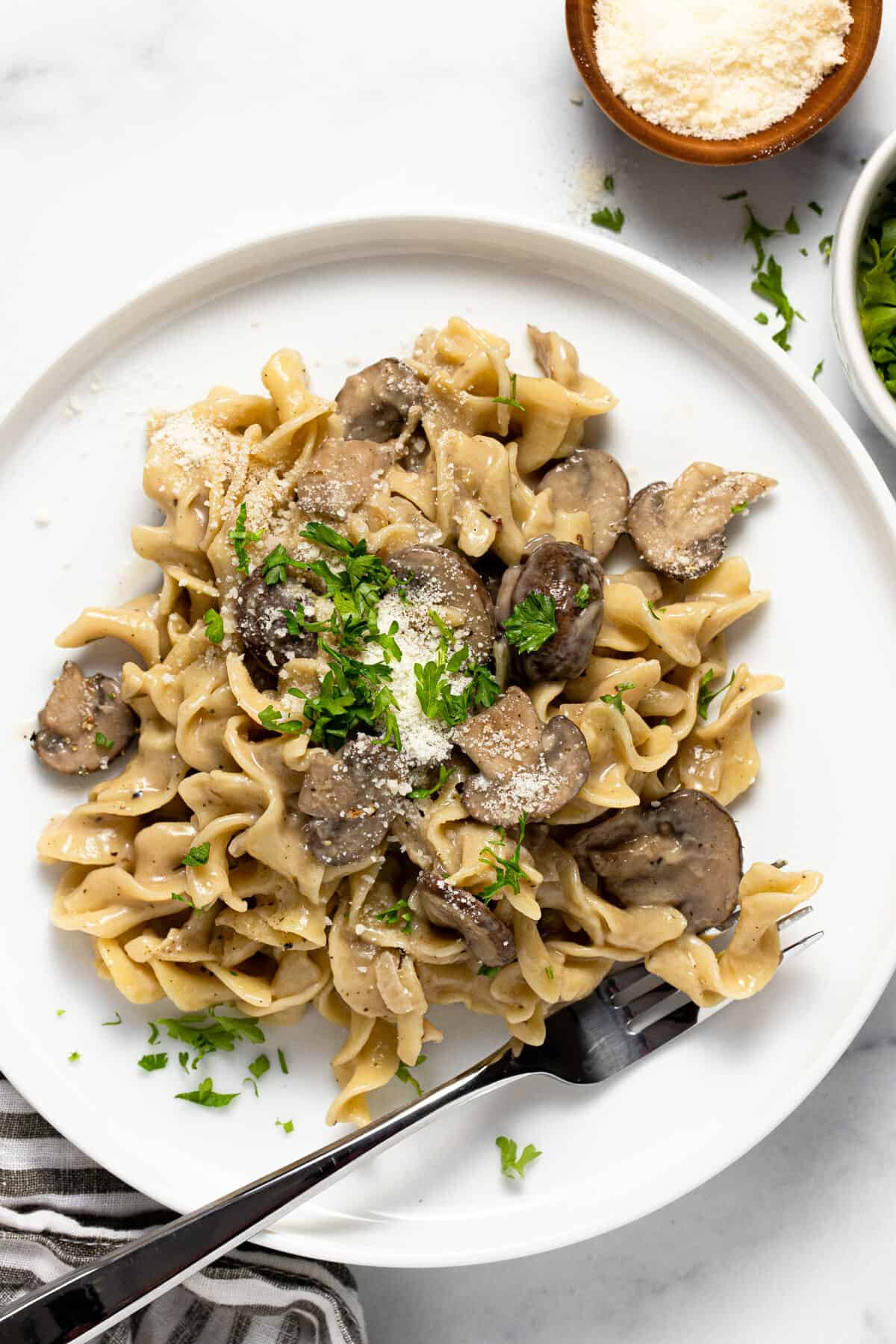 Large white plate filled with one pot mushroom stroganoff garnished with parsley