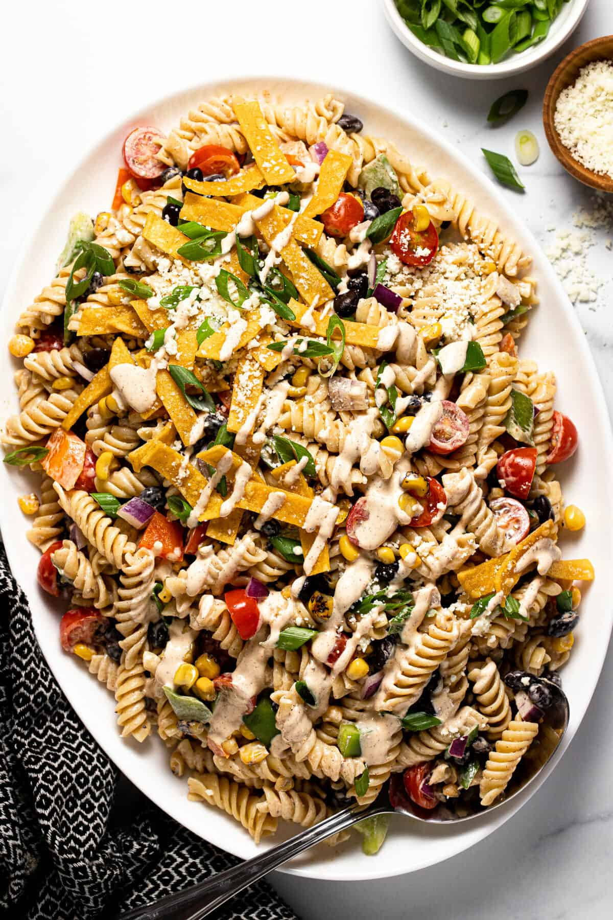 Large white serving platter filled with homemade creamy taco pasta salad