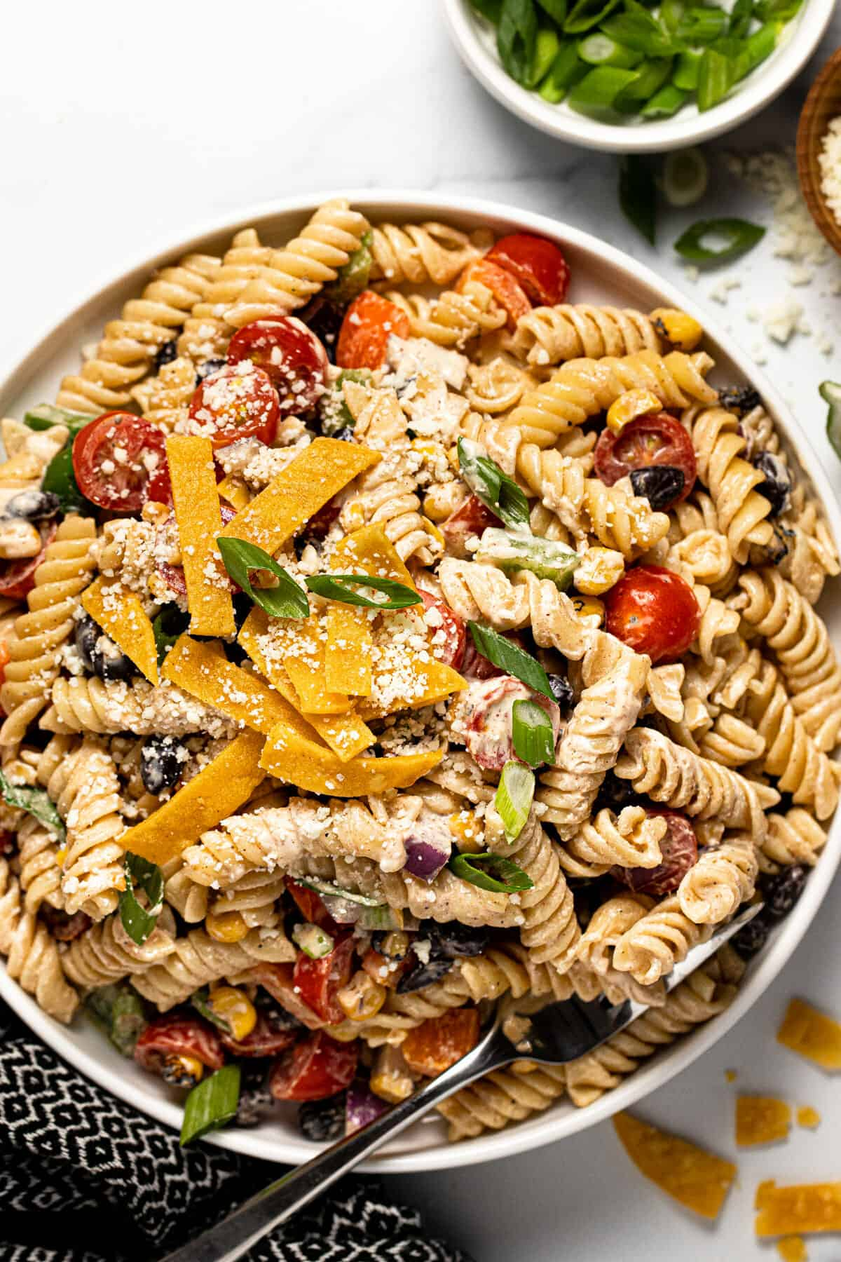 Small white bowl filled with taco pasta salad