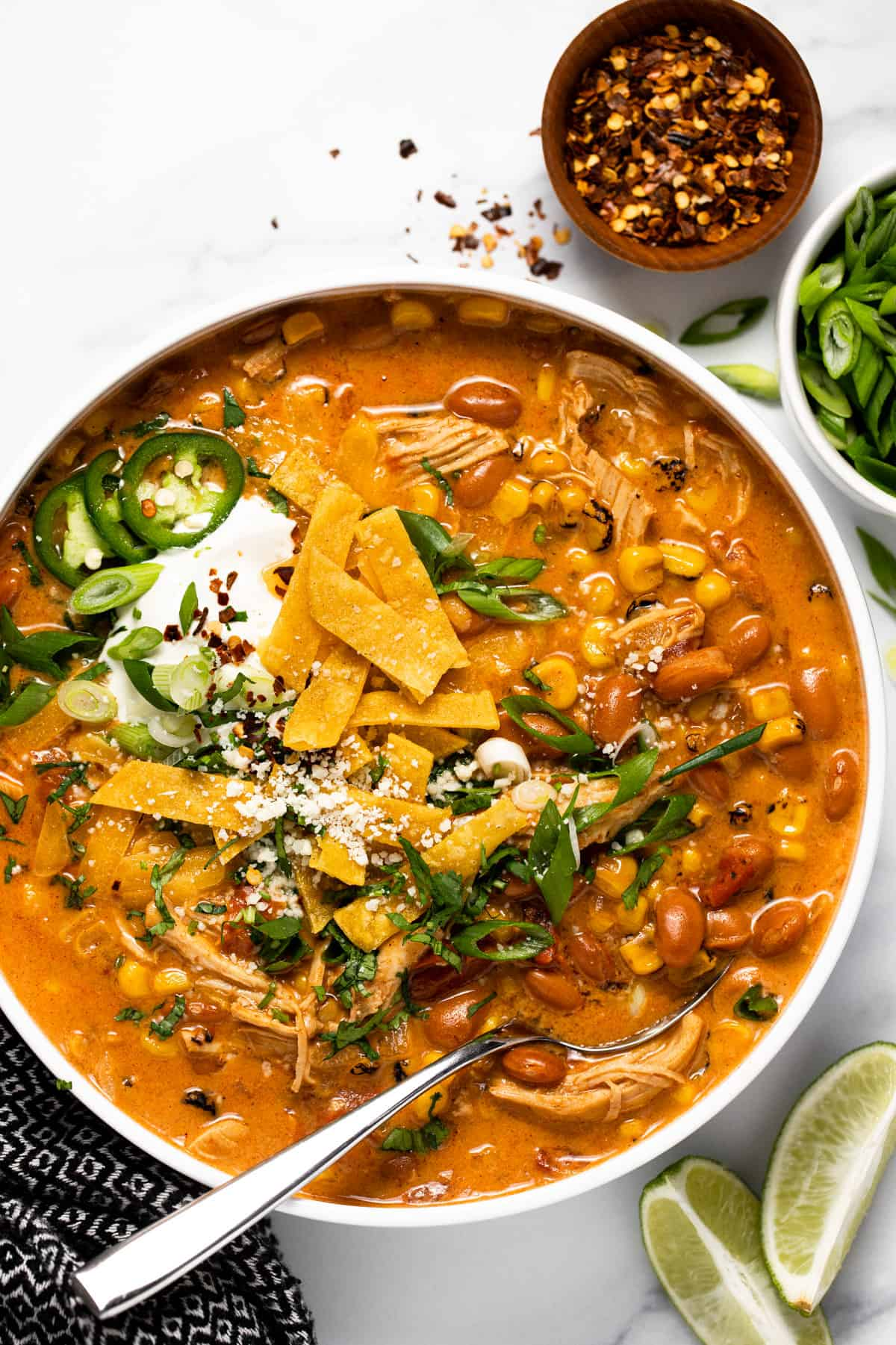 Large white bowl filled with creamy southwest chicken chili