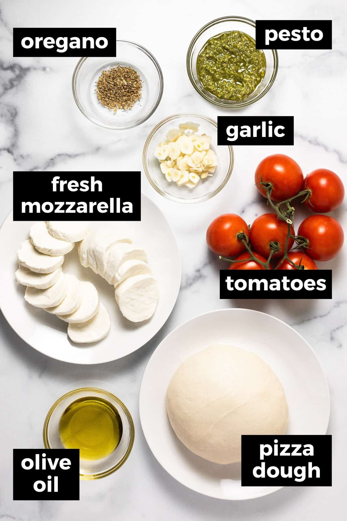 White marble counter top with ingredients to make margherita flatbread