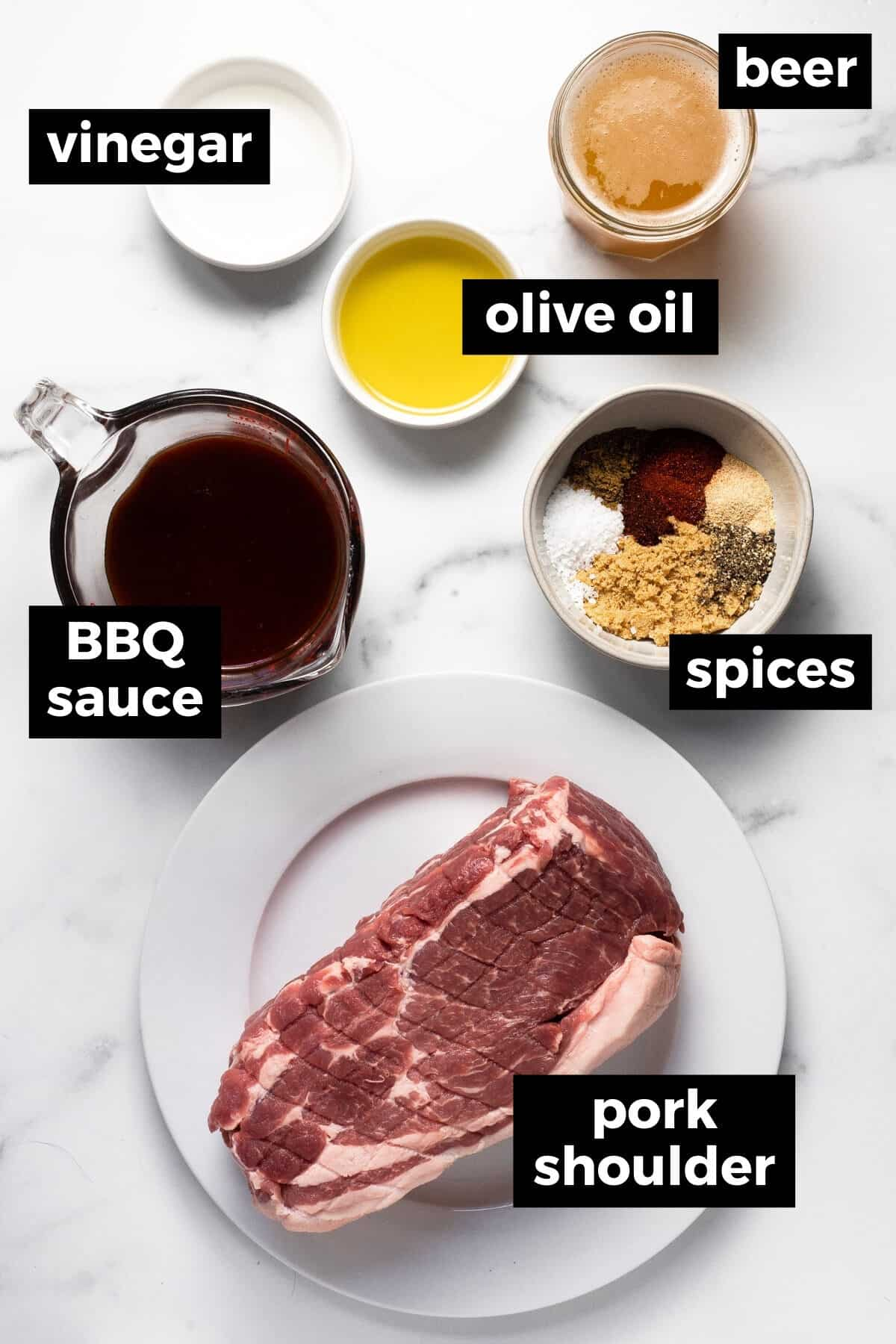 White marble counter top with ingredients to make pulled pork burgers