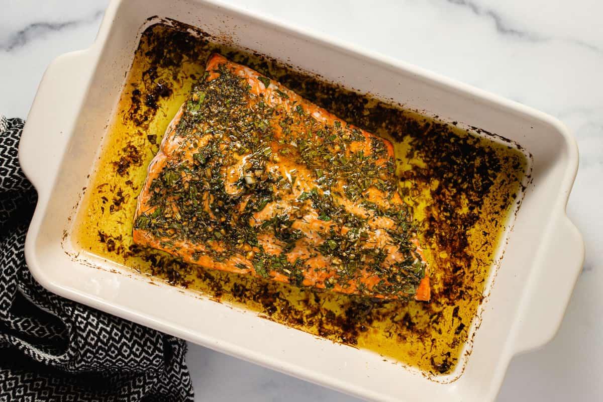 Large baking dish filled with freshly baked Greek salmon
