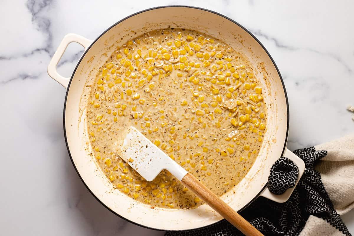 Large sauté pan filled with creamy corn sauce