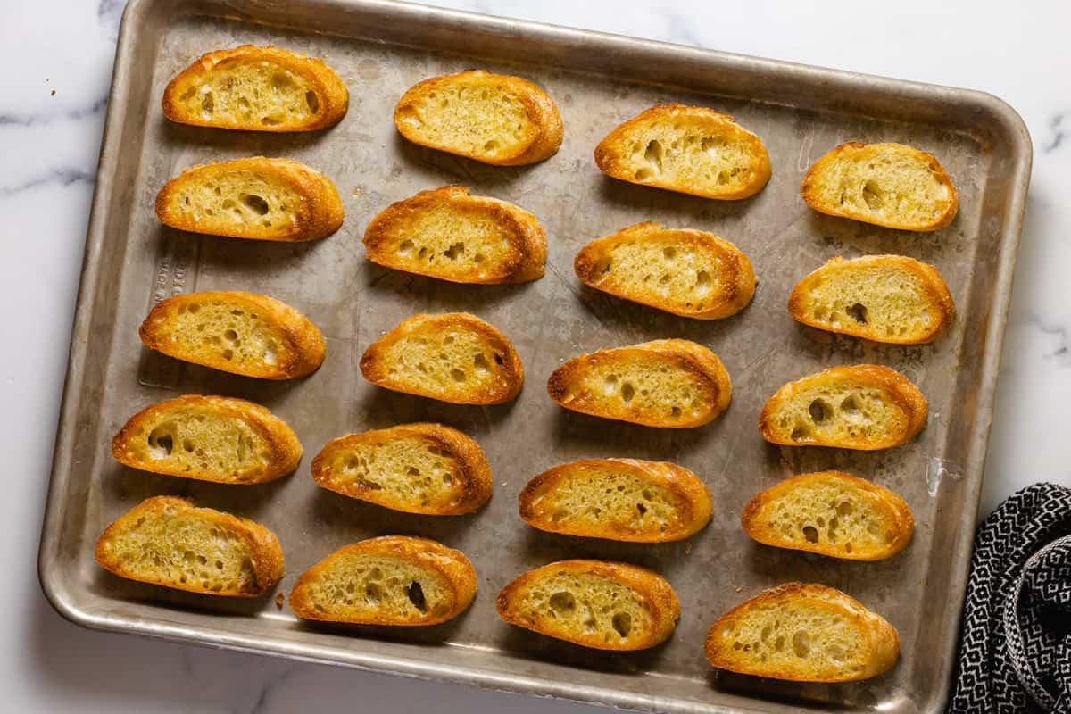 Metal pan filled with fresh baked crostini