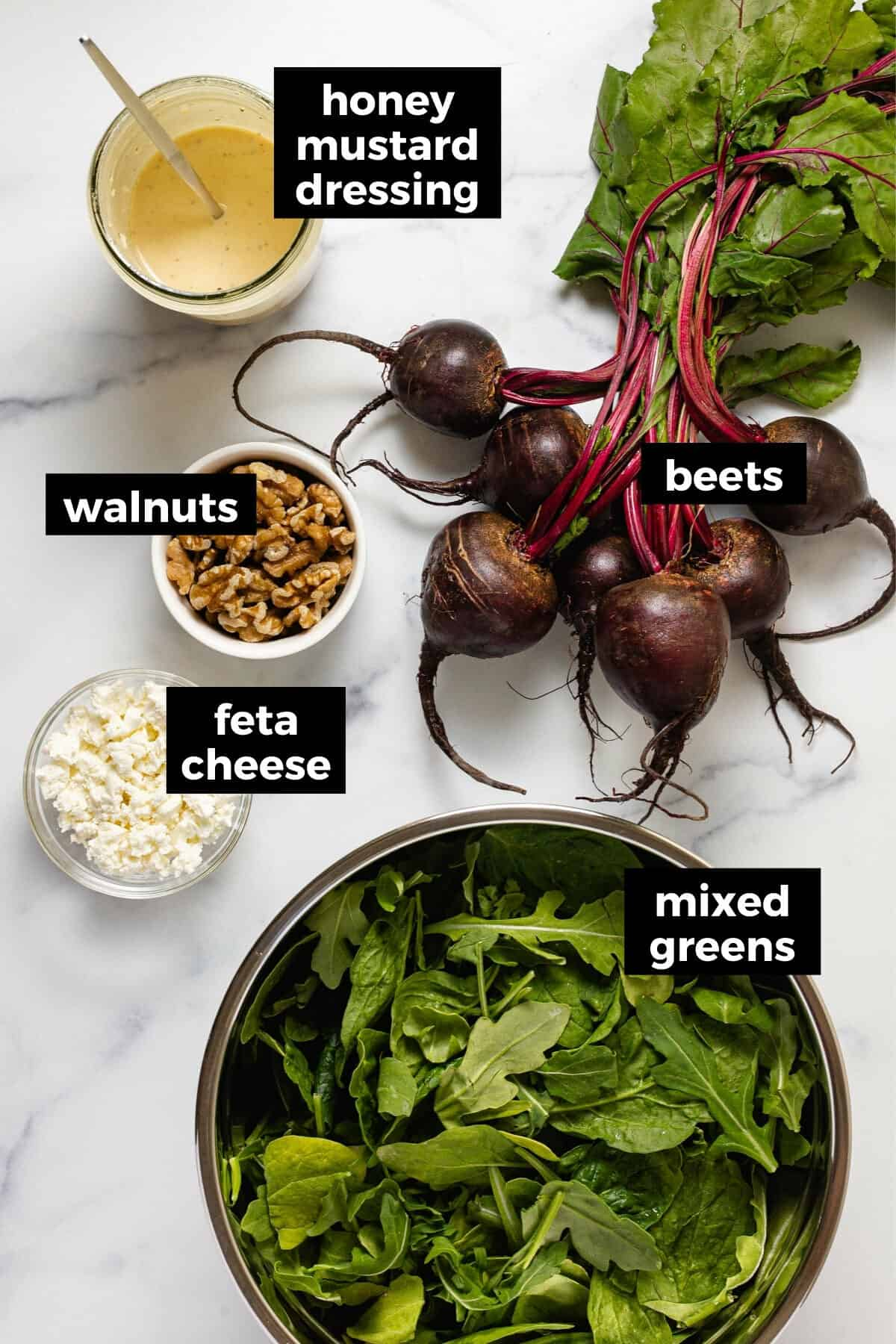 White marble counter top with ingredients to make beet and feta salad