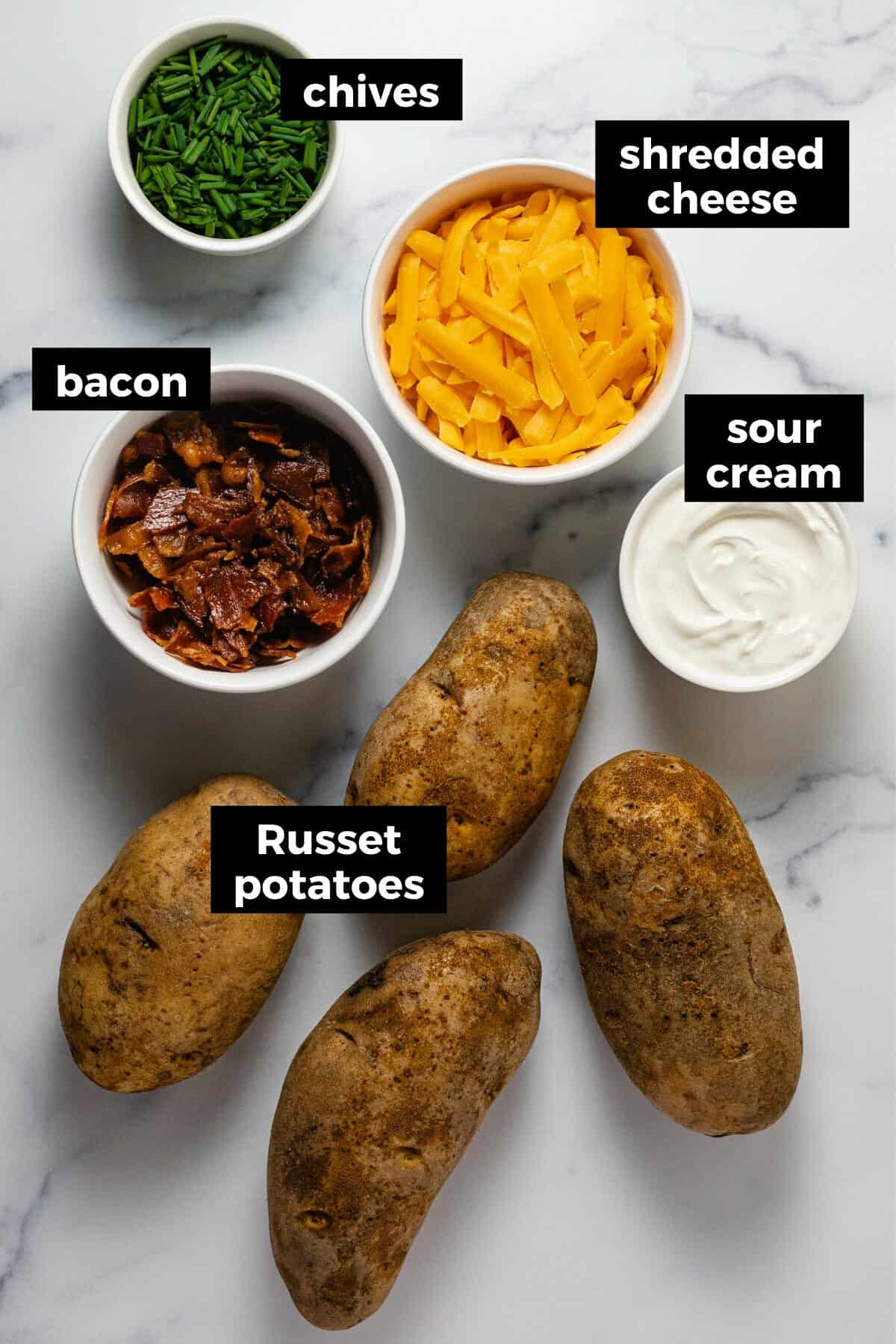 White marble counter top with ingredients to make instant pot baked potatoes