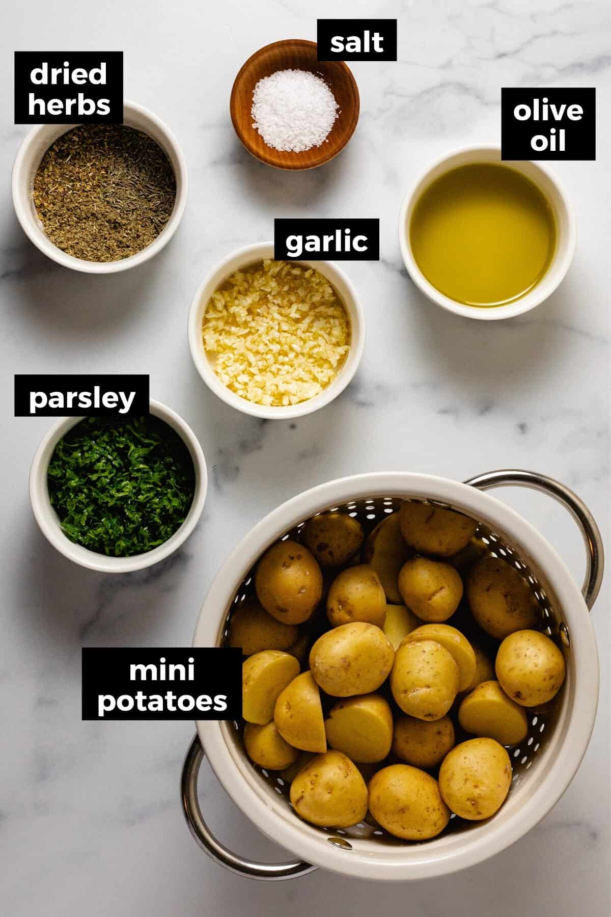 White marble counter top with ingredients to make roasted potatoes