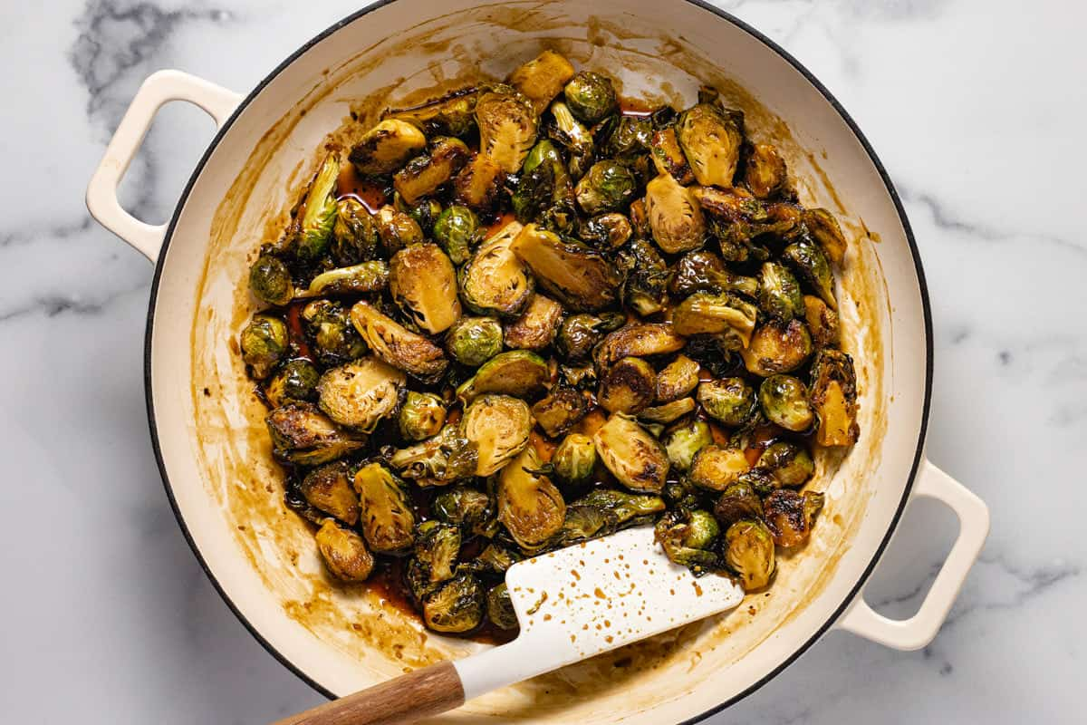 Large white pan filed with balsamic glazed Brussel sprouts