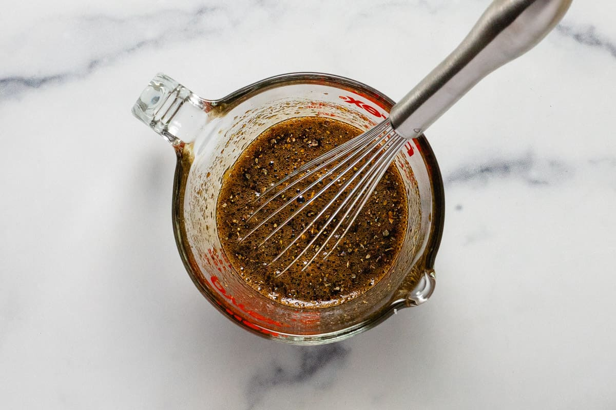 Measuring cup filled with ingredients for the balsamic glaze