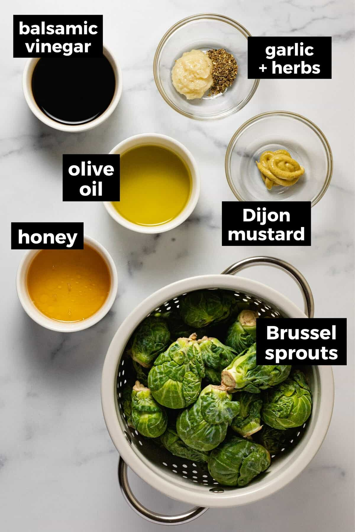 White marble counter top with ingredients to make balsamic glazed Brussel sprouts