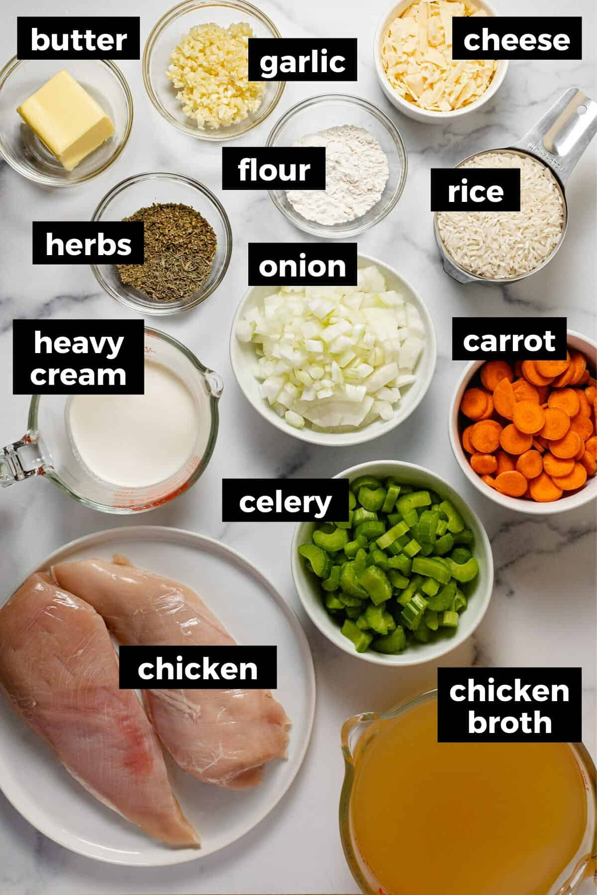 White marble counter top with ingredients to make chicken rice soup in the instant pot
